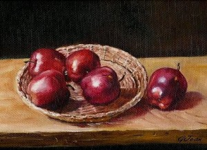RED APPLES IN BREAD BASKET